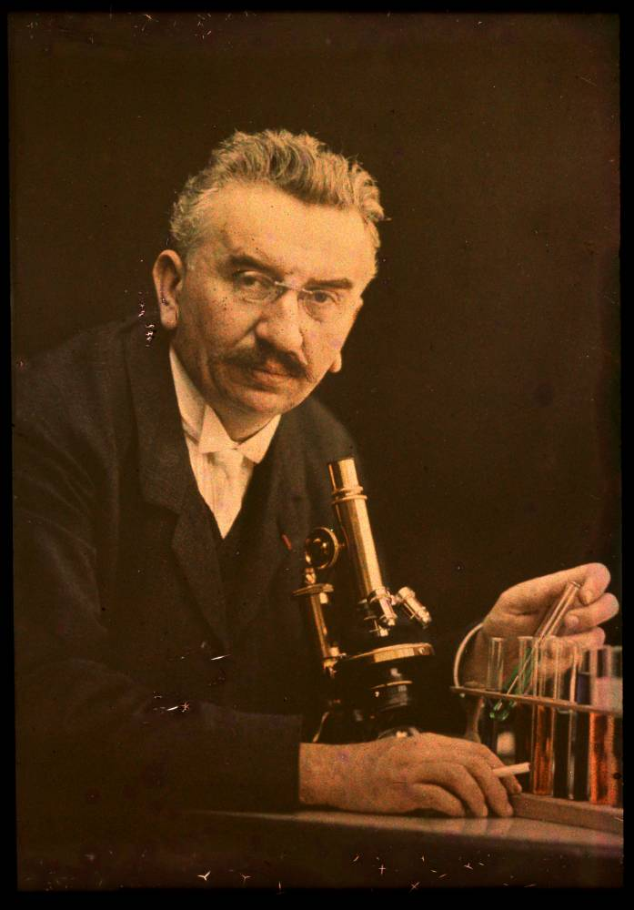 Louis Lumiere with microscope and test tubes Focus