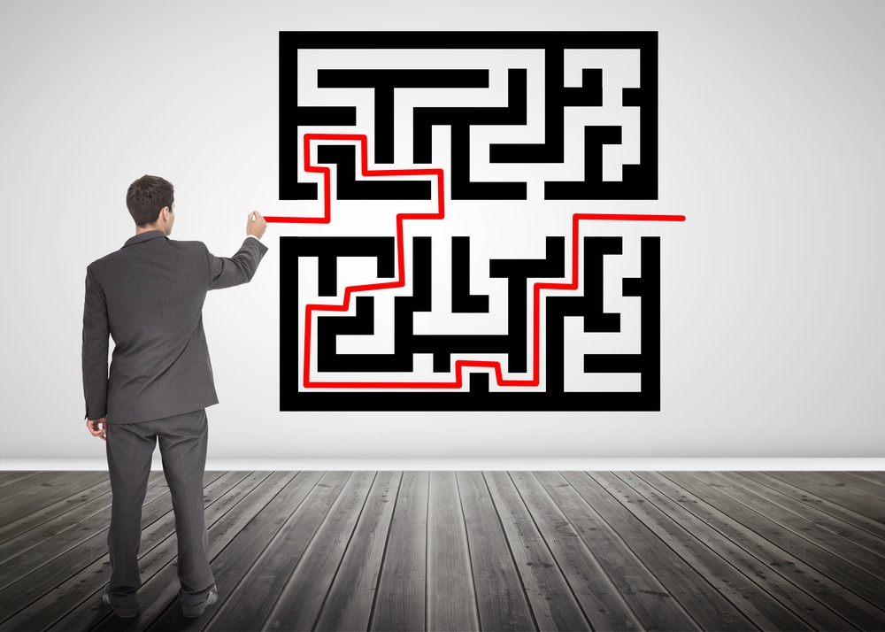 Businessman drawing a red line through qr code in empty room.jpeg