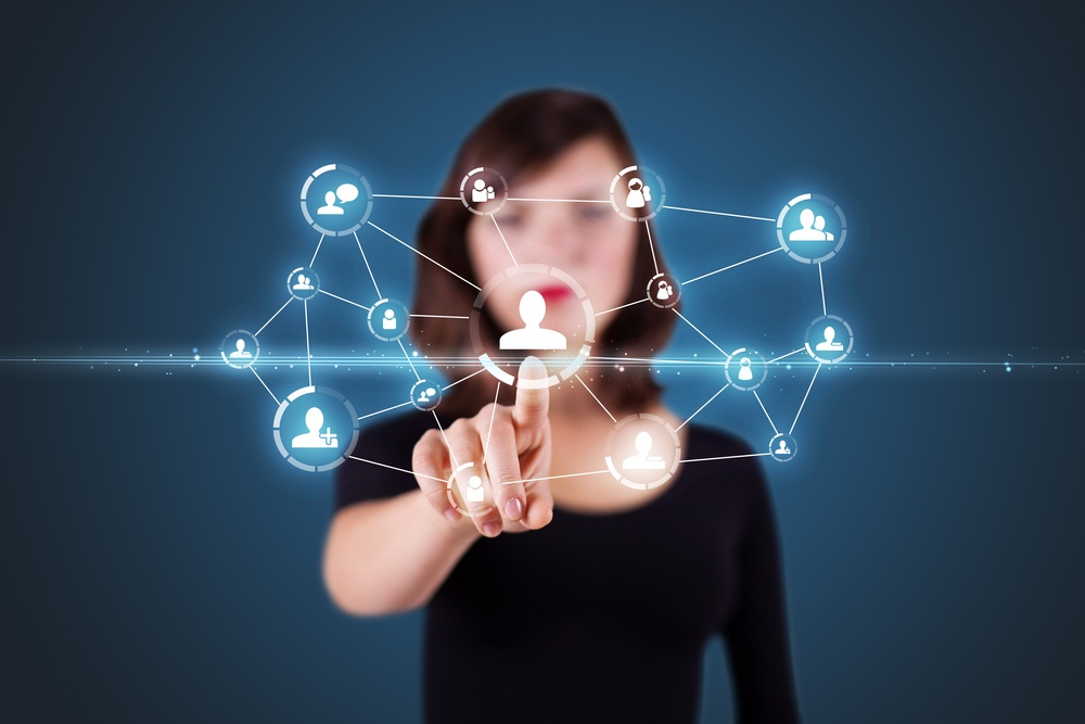 Businesswoman pressing modern social buttons on a virtual background.jpeg