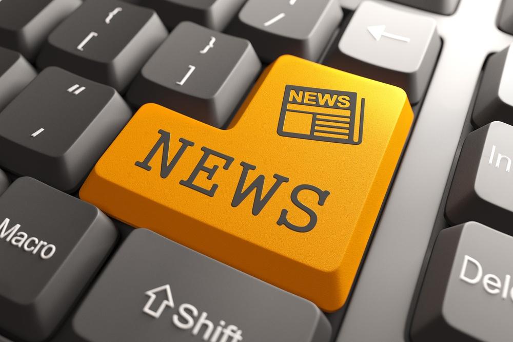 News - Orange Button with Newspaper Icon on Black Computer Keyboard. Mass Media Concept..jpeg