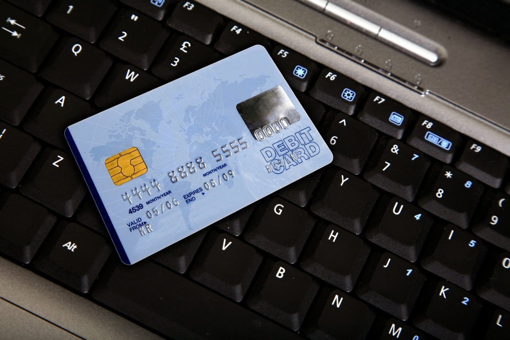 credit card over a computer keyboard - note the design of the card is my own.jpeg